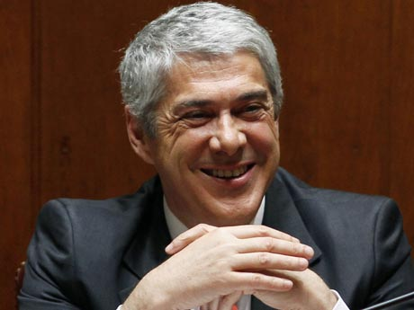 Portugal's Prime Minister Jose Socrates smiles in parliament during a no-confidence vote against the government in Lisbon